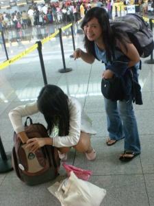 1445. Haze doublechecks her stuff at the airport